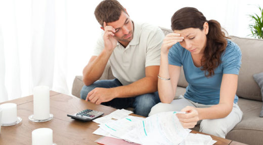 parents worry while looking at financial documents